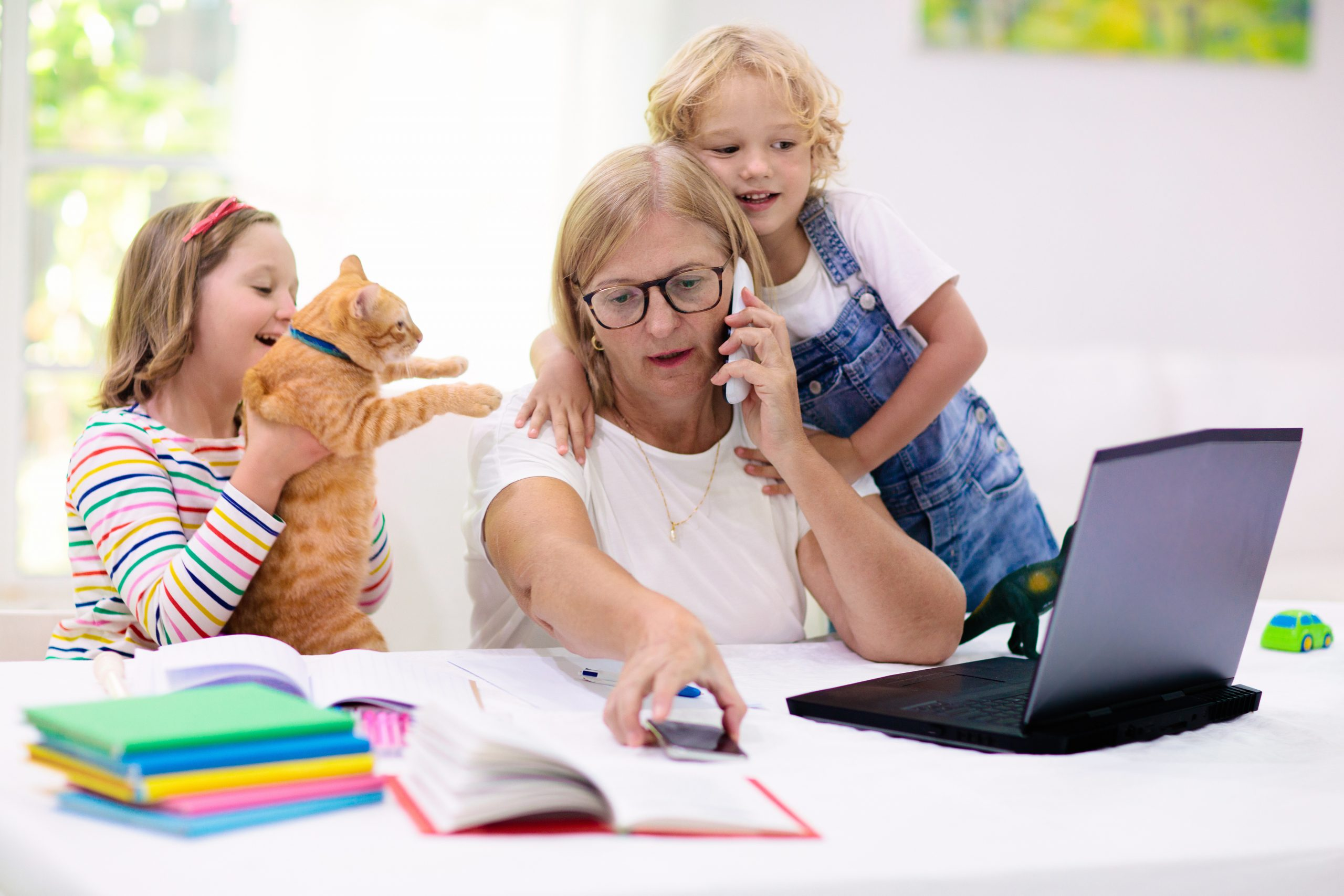 busy_stressed_mom_working_from_home_with_kids